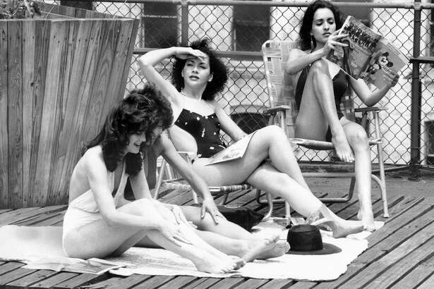 UNITED STATES - MAY 26:  Upon the roof of a building on East 39th Street, models (left to right) Michelle Mayfield, Feline Terrell, Regine Vavasseur, and Eileen Barker get an early start on their tans during the first day of Memorial Day Weekend.  (Photo by Robert Rosamilio/NY Daily News Archive via Getty Images)