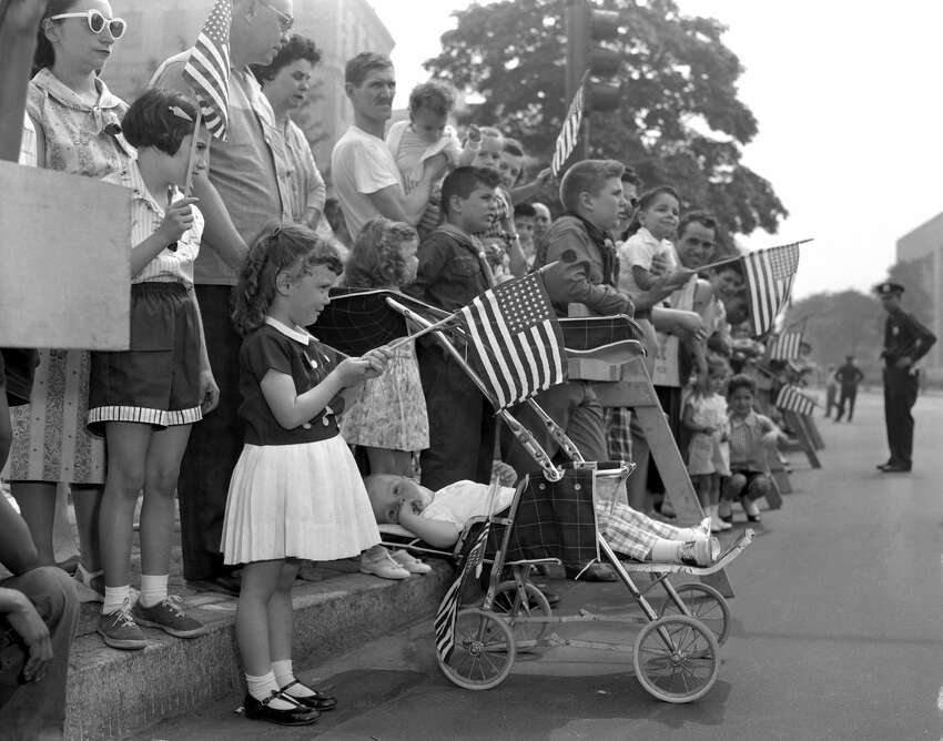 UNITED STATES - MAY 30: James Manico takes it easy in carriage as his sister, Gail (left), 4, watches the Memorial Day Parade on Eastern Parkway, Brooklyn. (Photo by Paul Bernius/NY Daily News Archive via Getty Images)