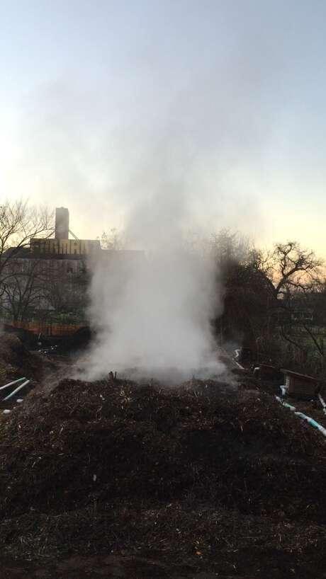 A Farm Dirt compost heap, giving off steam on a cold morning. Photo: Farm Dirt