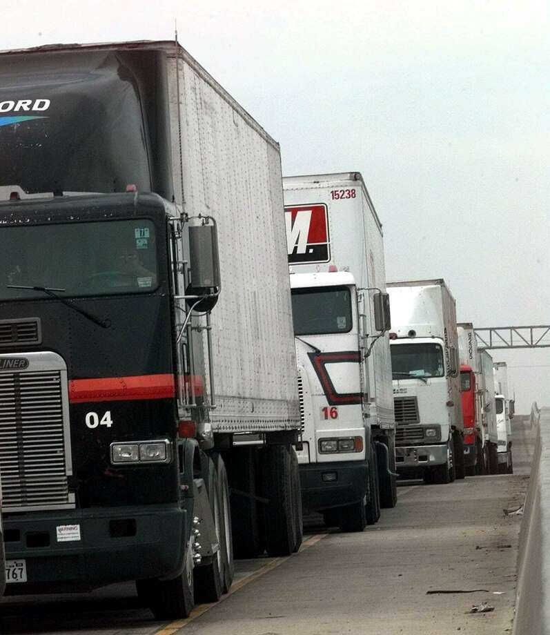 Eighteen-wheelers heading south to Mexico line up on Interstate 35 in Laredo, Texas in 1999. The North American Free Trade Agreement has been a shot in the arm for Laredo, but it's also meant treamendous resource-straining growth. Photo: LM OTERO /AP / AP