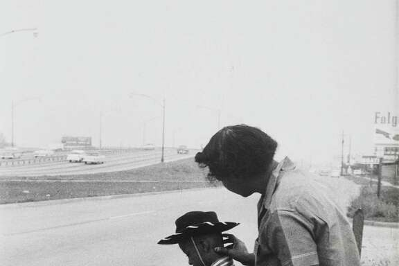 """""""Alongside Interstate 45 Freeway - Boy With Mother, 1957"""" is on view in """"Life Is Once, Forever: Henri Cartier-Bresson Photographs"""" at the Menil Collection through July 24."""
