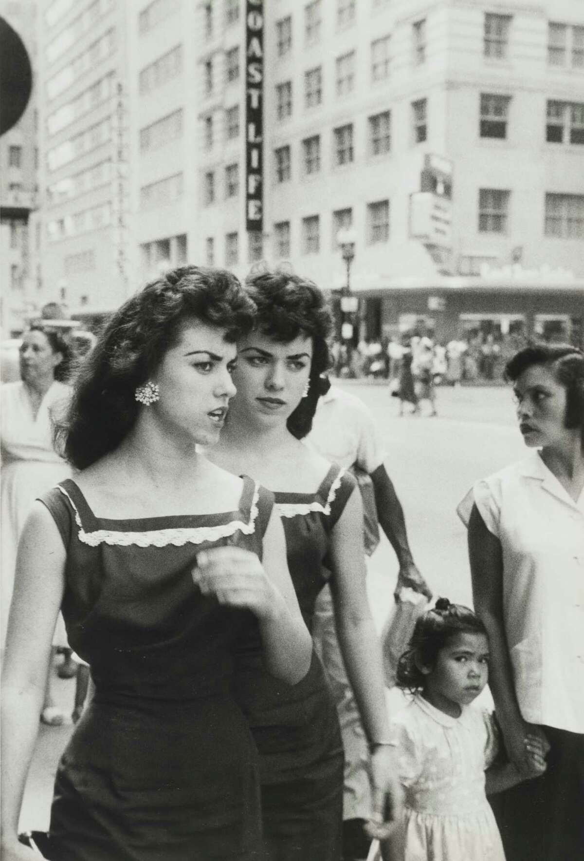 """""""Twins on Street, Downtown,"""" 1957, by photographer Henri-Cartier Bresson. The photo is part of the Menil Collection show """"Life is Once, Forever: Henri Cartier-Bresson Photographs."""""""