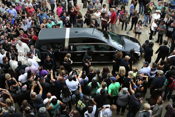 Members of the Navaira family walk past the hearse following the funeral service for Grammy-winning Tejano star Emilio Navaira at San Fernando Cathedral. A reader laments the intrusive behavior of some fans, who had to be cautioned by the funeral home staff to give family members some space.