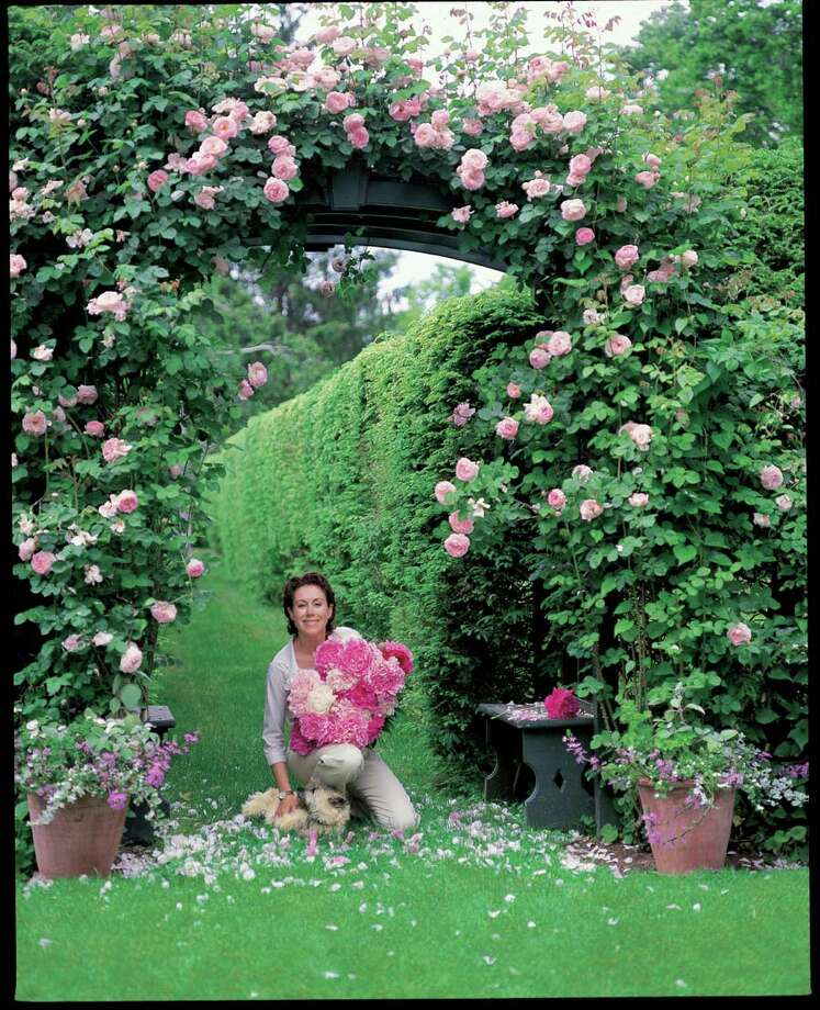 """Carolyne Roehm loves roses and peonies in her garden, where Annie, her dog, is a constant presence. Her latest book, """"Carolyne Roehm at Home in the Garden,"""" tours the gardens of her Connecticut estate, Weatherstone. Photo: Contributed Photo / Connecticut Post contributed"""