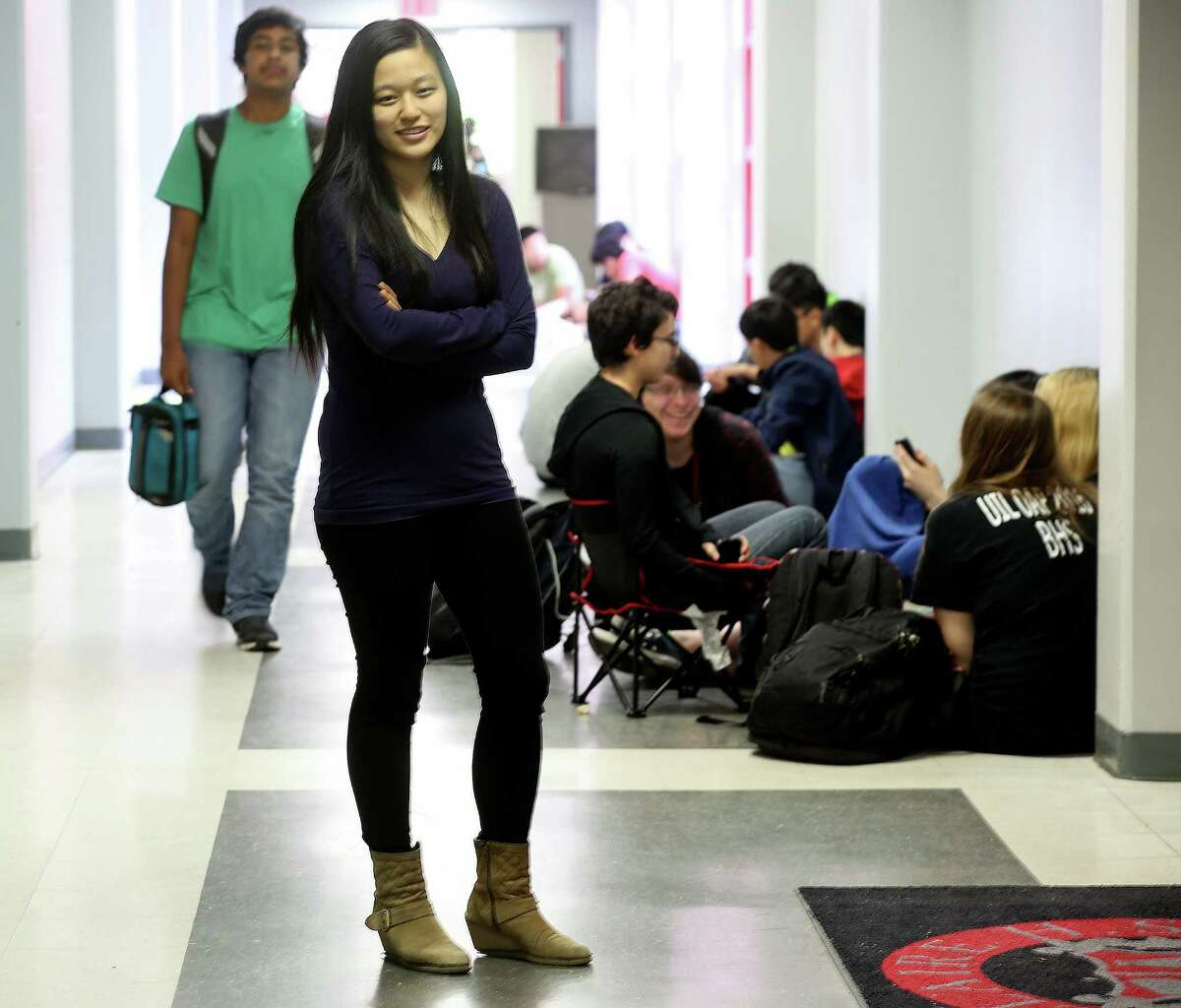 Liana Wang, a senior at Bellaire High School, poses in her school.