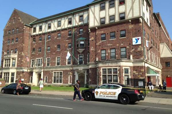 A 15-year-old boy was in critical condition in Bridgeport Hospital's trauma unit and his alleged assailant was in custody Friday afternoon following a reported stabbing in a parking lot at the YMCA on State Street.