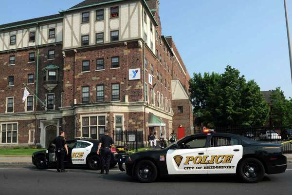 Police outside the YMCA on State Street in Bridgeport on Friday. A 15-year-old boy was in critical condition a reported stabbing in a parking lot at the YMCA on State Street in Bridgeport, Conn. on Friday, May 27, 2016.