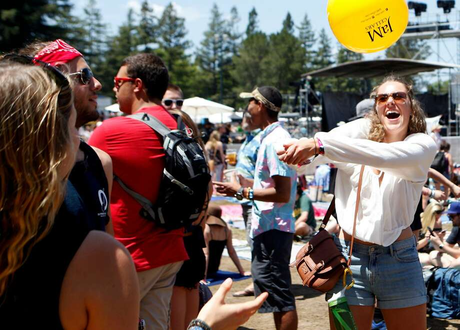 "Maggi Kepler plays a game of ""keep it up"" with friends before The Score performance at the Bottle Rock 2016 festival in Napa. Photo: Michael Noble, The Chronicle"