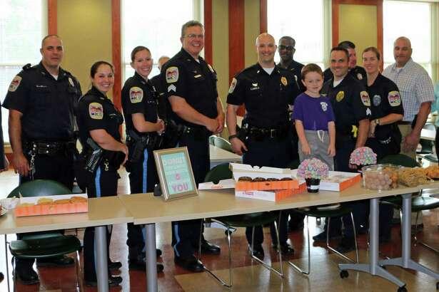 Logan Almeida, 5, with members of the Danbury Police Department