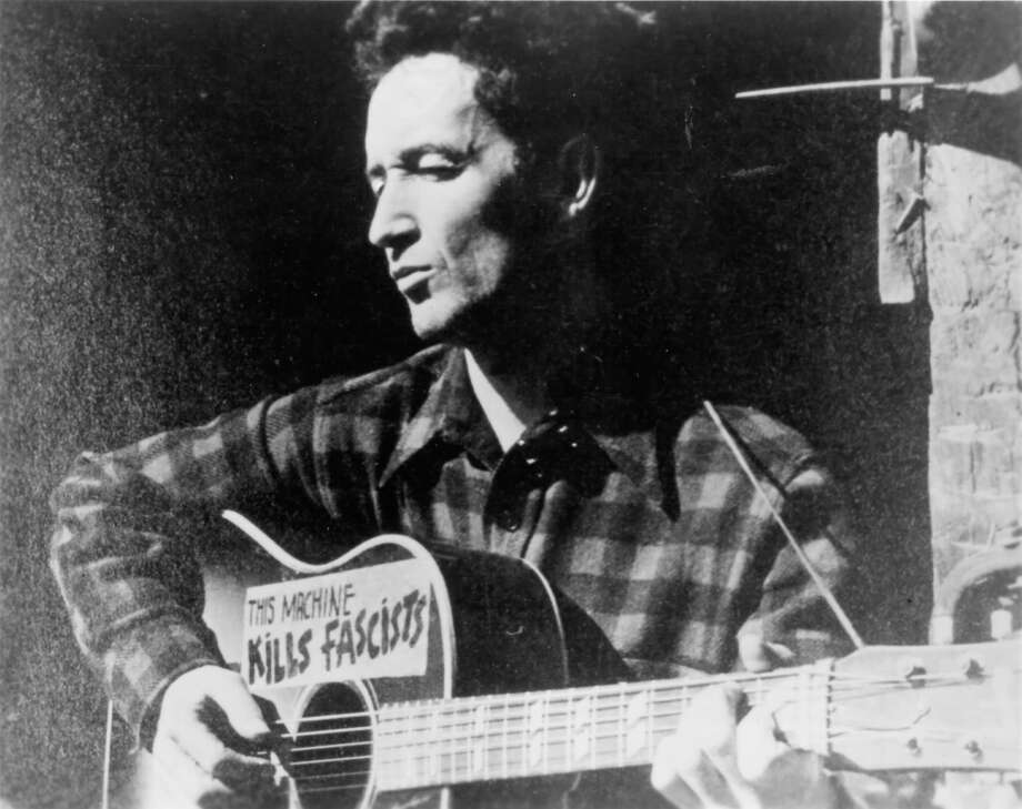 Folksinger Woody Guthrie traveled Washington and Oregon 75 years ago penning songs that would capture the Northwest as it was in the last days of the Great Depression. Take a look at Washington in 1941 as the state on Saturday marks Woody Guthrie Day. Photo: Michael Ochs Archives/Getty Images