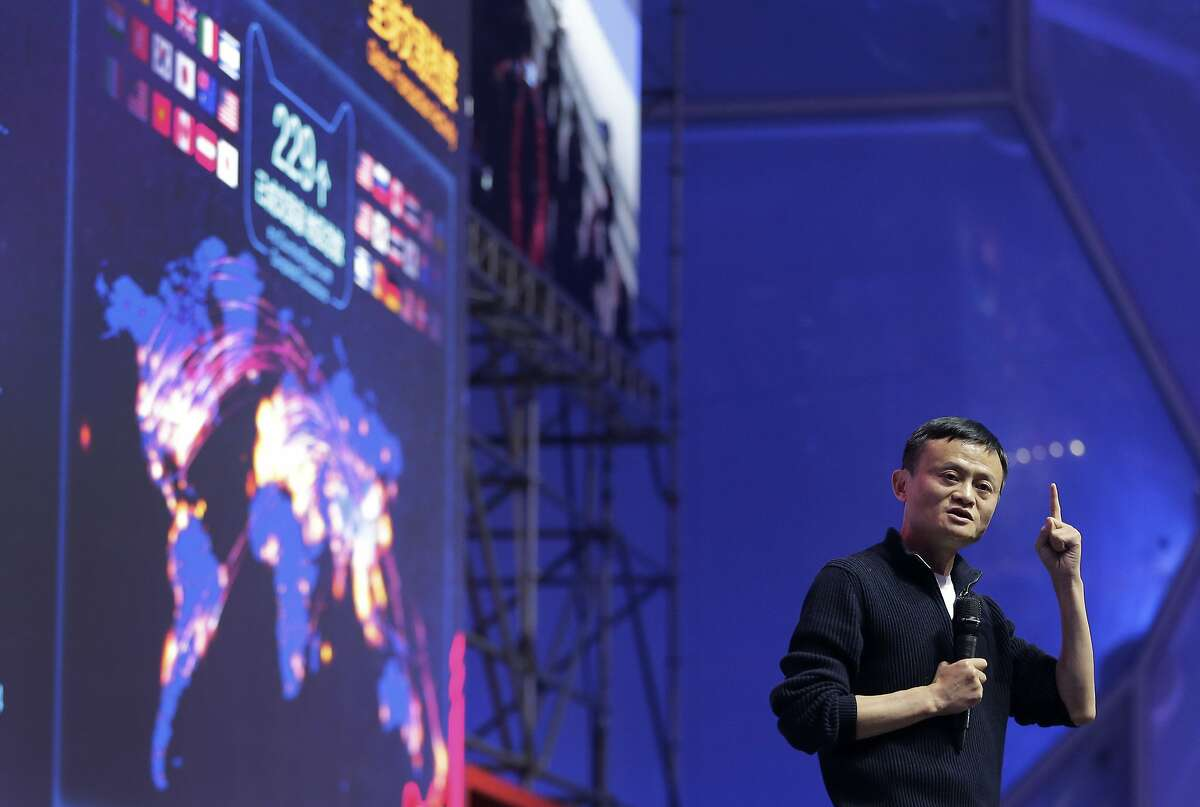 FILE - In this file photo taken Nov. 11, 2015, Jack Ma, executive chairman of the Alibaba Group speaks in front of a giant screen showing real-time sales figures of e-commerce giant Alibaba, during a press conference for the