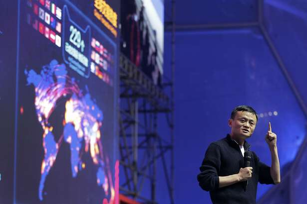 "FILE - In this file photo taken Nov. 11, 2015, Jack Ma, executive chairman of the Alibaba Group speaks in front of a giant screen showing real-time sales figures of e-commerce giant Alibaba, during a press conference for the ""Singles' Day"" online shopping festival held at National Aquatic Center, also known as the ""Water Cube"" in Beijing, China. Alibaba's relationship with an anti-counterfeiting lobby coalition known as the International Anti-Counterfeiting Coalition is a tale of how one of China's corporate giants won _ and ultimately lost_ a friend in Washington, using legal methods long deployed by corporate America: money and friendship. (AP Photo/Andy Wong)"