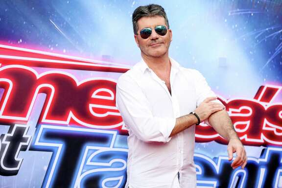 "Simon Cowell arrives at the ""America's Got Talent"" Season 11 Red Carpet Kickoff at the Pasadena Civic Auditorium on Thursday, March 3, 2016, in Pasadena, Calif. (Photo by Rich Fury/Invision/AP)"