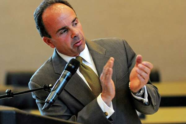 Bridgeport Mayor Joe Ganim fulfilled a campaign promise on Friday, signing a budget that will include 100 new police officers.