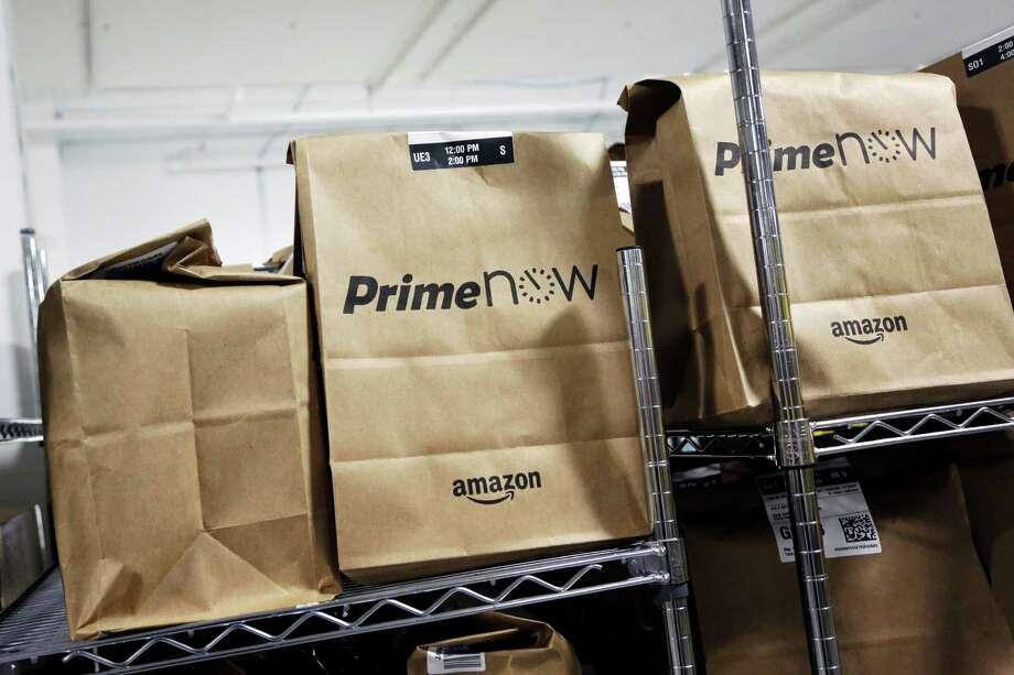 Amazon Prime Now launched one-hour meal delivery service in Houston on Wednesday. Photo: Mark Lennihan, STF / AP