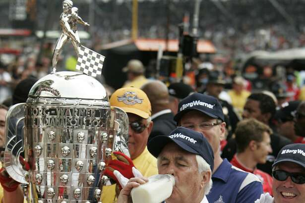 FILE - In this May 24, 2009, file photo, car owner Roger Penske drinks milk after his driver, Helio Castroneves, of Brazil, won the Indianapolis 500 auto race at Indianapolis Motor Speedway in Indianapolis. With all the hoopla surrounding the 100th Indianapolis 500, Roger Penske has a celebration of his own going � the 50th anniversary of Team Penske. (AP Photo/Michael Conroy, File)