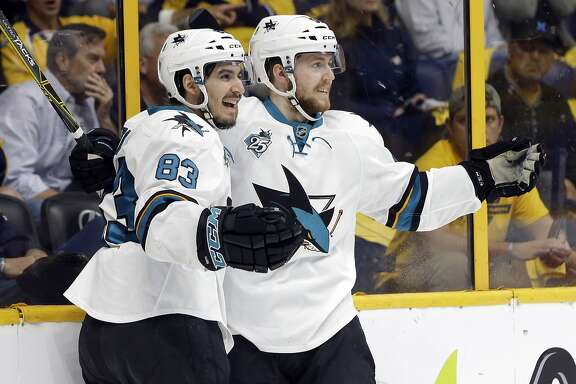 San Jose Sharks center Chris Tierney, right, celebrates with Matt Nieto (83) after Tierney scored a goal against the Nashville Predators during the first period in Game 6 of an NHL hockey Stanley Cup Western Conference semifinal playoff series Monday, May 9, 2016, in Nashville, Tenn. (AP Photo/Mark Humphrey)