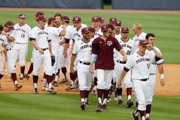 Texas A&M players celebrate after defeating Vanderbilt 13-3 in a Southeastern Conference NCAA college baseball tournament game at the Hoover Met, Friday, May 27, 2016, in Hoover, Ala. (AP Photo/Brynn Anderson)