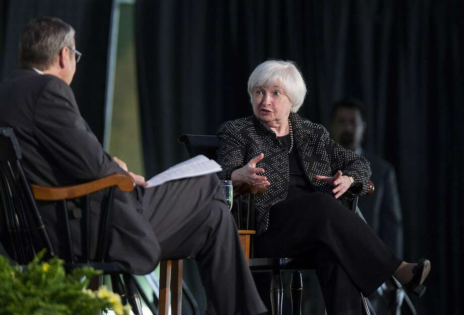 Janet Yellen (right), chairwoman of the Federal Reserve, discusses the economy and potential rate hikes Friday at Harvard University with Gregory Mankiw, chairman of the school's economics department. Photo: Scott Eisen, Bloomberg