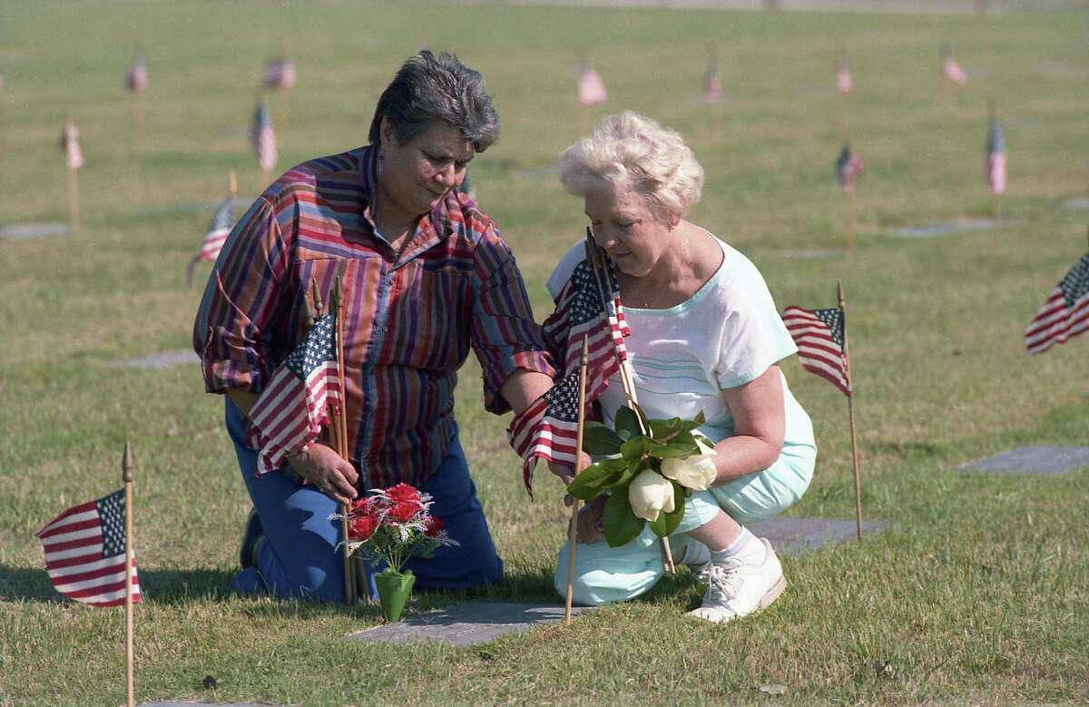 Katherine Lewis, left, and Opal Johnson visit the grave of Robert A. Johnson, who was killed in 1967 in Vietnam, at the Houston National Cemetery, May 19,1986.