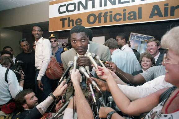 Hakeem Olajuwon greets fans at Intercontinental Airport after the Rockets defeated the Los Angeles Lakers, 114-112, to win the 1986 West Conference Finals, May 22, 1986.