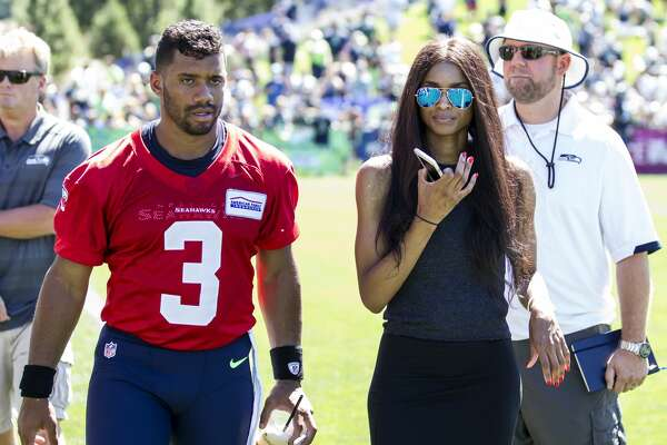 Seattle Seahawks quarterback Russell Wilson and girlfriend Ciara during an NFL football training camp on Friday, July 31, 2015, in Renton, Wash. (AP Photo/Stephen Brashear)