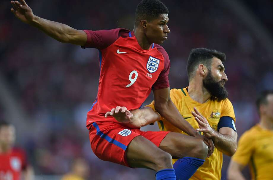England's Marcus Rashford, who scored in the third minute, battles Australia's Mile Jedinak. Photo: PAUL ELLIS, AFP/Getty Images