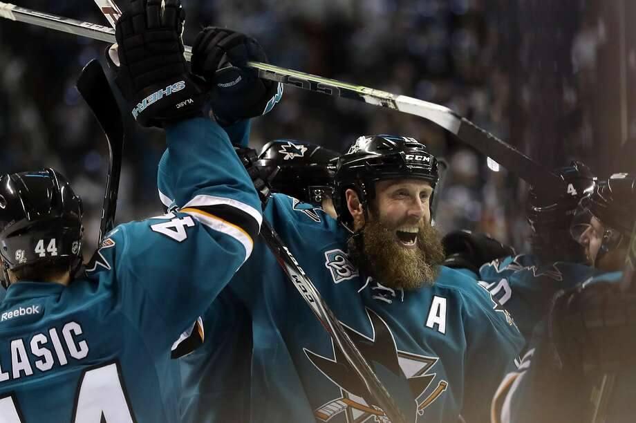 SAN JOSE, CA - MAY 25:  Joe Thornton #19 of the San Jose Sharks celebrates with Marc-Edouard Vlasic #44 of the San Jose Sharks after they beat the St. Louis Blues in Game Six of the Western Conference Final during the 2016 NHL Stanley Cup Playoffs at SAP Center on May 25, 2016 in San Jose, California.  (Photo by Ezra Shaw/Getty Images) Photo: Ezra Shaw, Getty Images