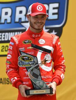 NASCAR Sprint Cup driver Kyle Larson celebrates victory in the 31st Annual Sprint Showdown race at Charlotte Motor Speedway in Concord, N.C., on Saturday, May 21, 2016. (Jeff Siner/Charlotte Observer/TNS)