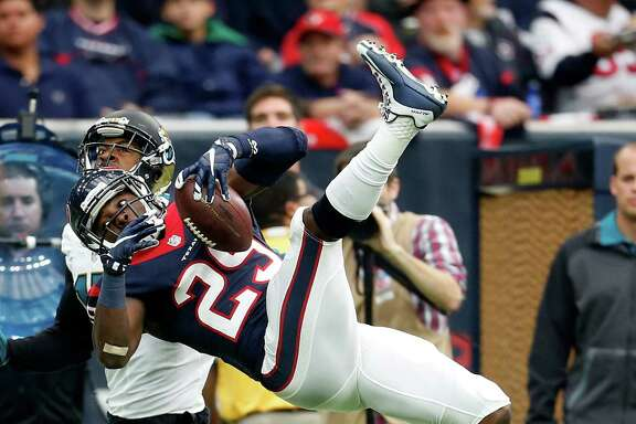 Houston Texans strong safety Andre Hal (29) hauls in an intercepted pass during the second quarter of an NFL football game at NRG Stadium on Sunday, Jan. 3, 2016, in Houston.  ( Karen Warren / Houston Chronicle )