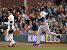 Nolan Arenado (28) jogs the bases after hitting a three-run homerun in the first inning. The San Francisco Giants played the Colorado Rockies at AT&T Park in San Francisco, Calif., on  Wednesday, April 15, 2015.