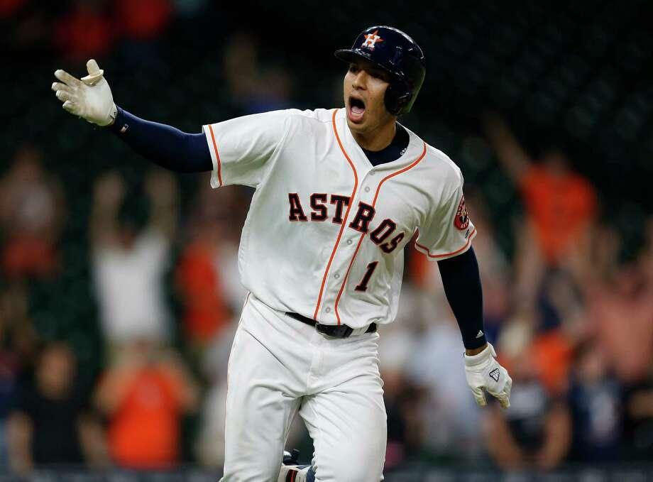 Astros give ... Carlos Correa