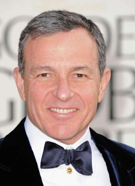 Walt Disney Co. CEO Robert Iger said he plans to stay on a presidential advisory panel after activists at the company's annual shareholder meeting Wednesday asked him to step down from the position. Photo: Associated Press /File Photo / AP2013