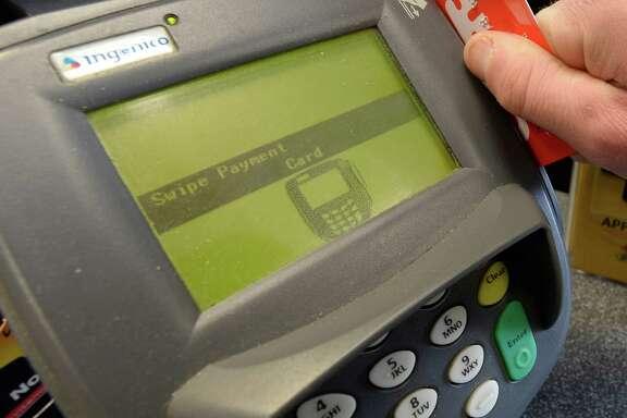 Photo Illustration of a credit card swipe unit Feb. 24, 2014 in Albany, N.Y.      (SKIP DICKSTEIN / Times Union)