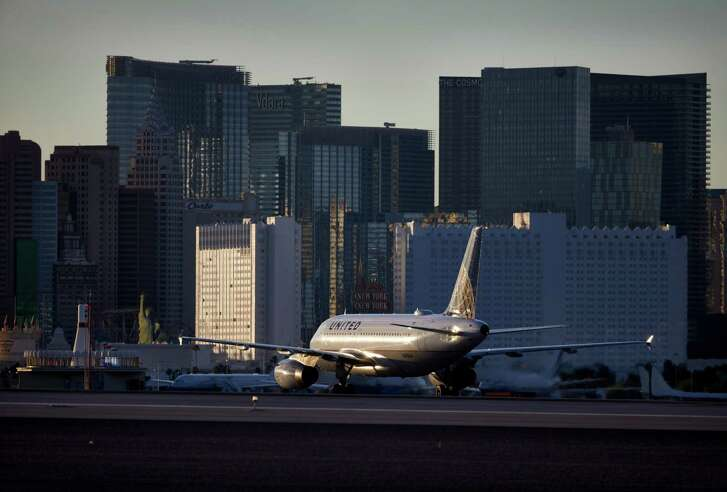 In this May 16, 2016, photo, a plane taxis toward the terminal after landing at McCarran International Airport in Las Vegas. An Associated Press investigation has documented perimeter breaches at many of the busiest airports in the U.S. (AP Photo/John Locher)
