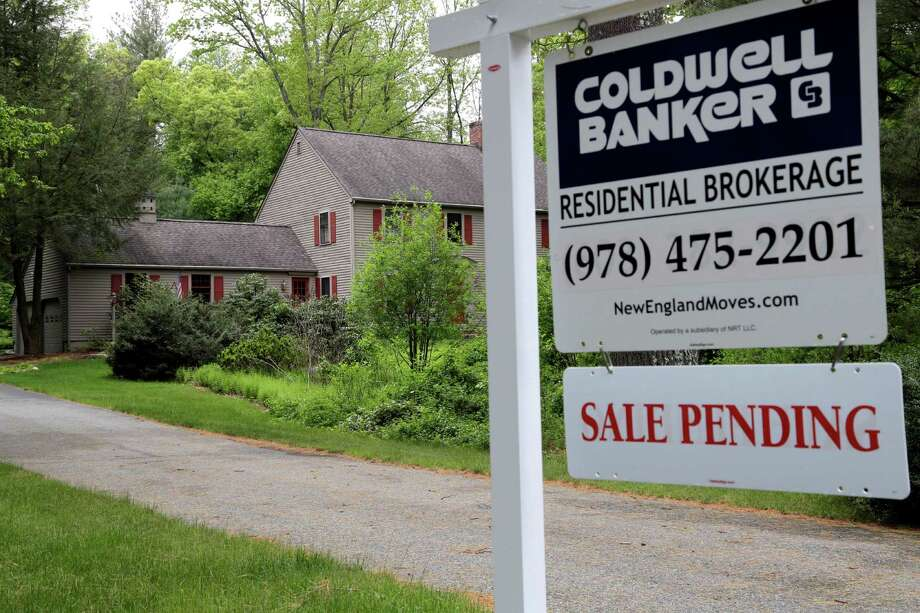 "This Tuesday, May 24, 2016, photo shows a ""Sale Pending"" sign in front of a house in North Andover, Mass. On Thursday, May 26, 2016, the National Association of Realtors releases its April report on pending home sales, which are seen as a barometer of future purchases. (AP Photo/Elise Amendola) Photo: Elise Amendola, STF / Copyright 2016 The Associated Press. All rights reserved. This material may not be published, broadcast, rewritten or redistribu"