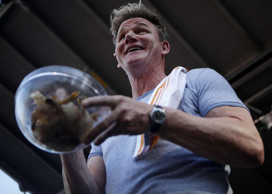 """Chef Gordon Ramsay teaches the crowd how to cook shrimp and other seafood at the """"Surprise Feature"""" at the Bottle Rock 2016 festival in Napa, Calif. on May 27, 2016. Photo: Michael Noble, The Chronicle"""