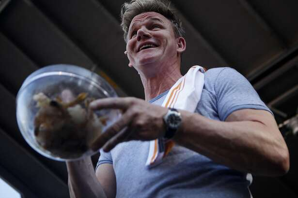 """Chief Gordon Ramsay teaches the crowd how to cook shrimp and other seafood at the """"Surprise Feature"""" at the Bottle Rock 2016 festival in Napa, Calif. on May 27, 2016."""