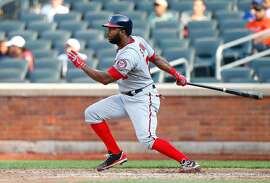 Denard Span #2 of the Washington Nationals follows through on an eighth inning double, extending his hitting streak to 23 games,  against the New York Mets at Citi Field on September 12, 2013 in the Flushing neighborhood of the Queens borough of New York City. The Nationals defeated the Mets 7-2.  (Photo by Jim McIsaac/Getty Images)
