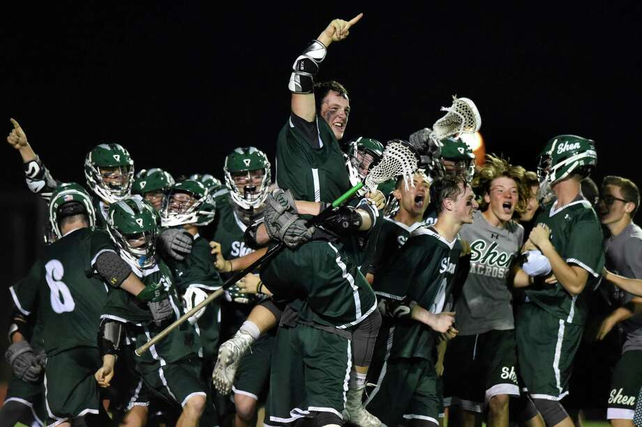 Shen's Hayden Haldane, center, jumps atop of his celebrating teammates as they win 15-14 over Niskayuna in their Class A lacrosse final on Friday, May 27, 2016, at Mohonasen High in Rotterdam, N.Y. (Cindy Schultz / Times Union) Photo: Cindy Schultz / Albany Times Union