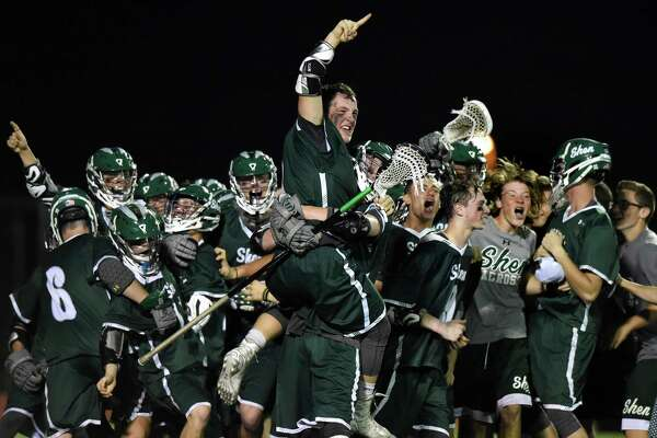 Shen's Hayden Haldane, center, jumps atop of his celebrating teammates as they win 15-14 over Niskayuna in their Class A lacrosse final on Friday, May 27, 2016, at Mohonasen High in Rotterdam, N.Y. (Cindy Schultz / Times Union)