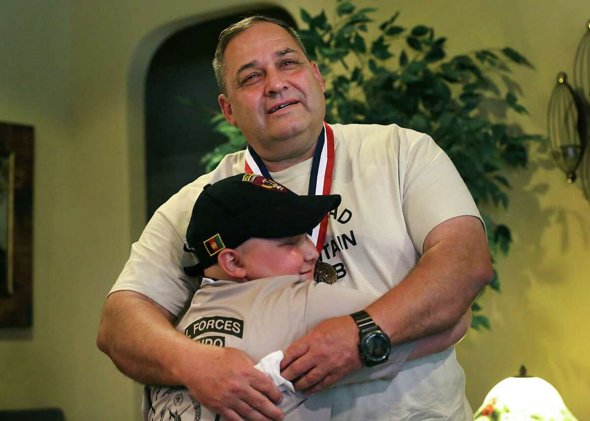 Lt. Col Jerry Touchet embraces a hugging Damon Billeck, a 12 yr-old cancer patient, as he is brought to tears after finally getting to meet the inspirational youngster on Friday, May, 27, 2016. The two had been writing to each other and sending gifts over the past two years.