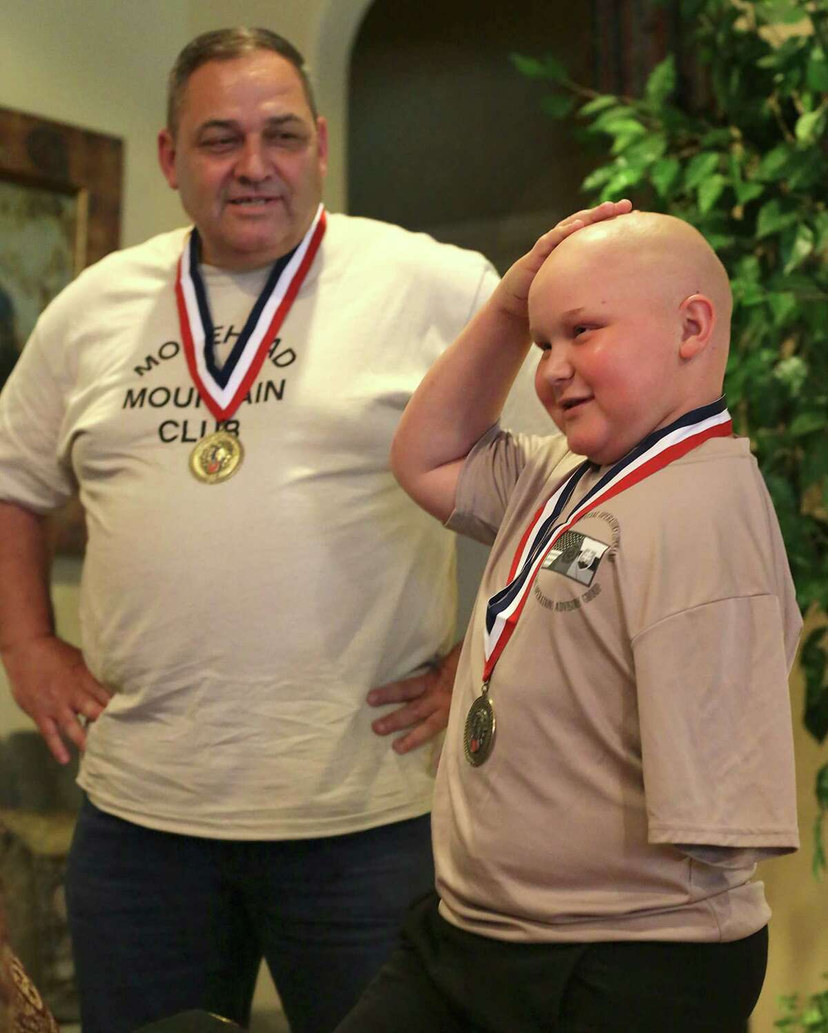 Lt. Col Jerry Touchet listens to his inspirational young friend cancer patient Damon Billeck, 12, as they finally got a surprise meeting on Friday, May, 27, 2016, after writing to each other and sending gifts over the past two years.