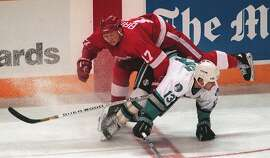 SHARKS/23APR95/SP/MACOR    San Jose Sharks vs. Detroit Redwings, Redwings- 17-Doug Brown (top) gets tangled up with Shark Jamie Baker.   Chronicle Photo: Michael Macor