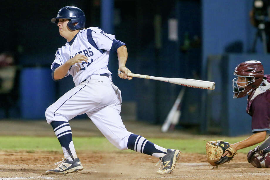 Boerne Champion's Mason Michalec hits a RBI single, driving in Charlie Shipp, during the sixth inning of the second game of their Class 5A regional semifinal series with Flour Bluff. Photo: Marvin Pfeiffer / San Antonio Express-News / Express-News 2016