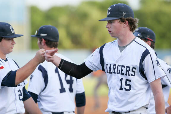 Boerne Champion's John Weber (right) heads to the duggout after pitching out of a bases loaded jam in the first inning of the second game of their Class 5A regional semifinal series with Corpus Christi Flour Bluff at the SAISD Complex on Friday, May 27, 2016.  Flour Bluff beat Champion 4-1 to force a final game on Saturday.  MARVIN PFEIFFER/ mpfeiffer@express-news.net