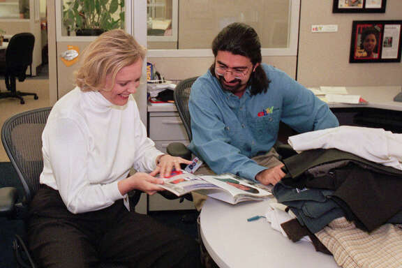File - In this May 21, 1999 file photo, eBay chief executive officer Meg Whitman, left, and Pierre Omidyar, eBay's chairman of the board, leaf through a magazine at the company's headquarters in San Jose, Calif. The courtroom fight between former pro wrestler Hulk Hogan and news-and-gossip site Gawker is becoming a battleground for Silicon Valley tycoons as well. First Look Media, a news organization financed by Omidyar, philanthropist and the co-founder of eBay, is reaching out to other media outlets to file supportive briefs about Gawker, according to the New York Post. The briefs could be used for the site's appeal of a $140 million invasion-of-privacy verdict Hogan won two months ago because Gawker posted a sex tape of him. (AP Photo/Randi Lynn Beach, File)