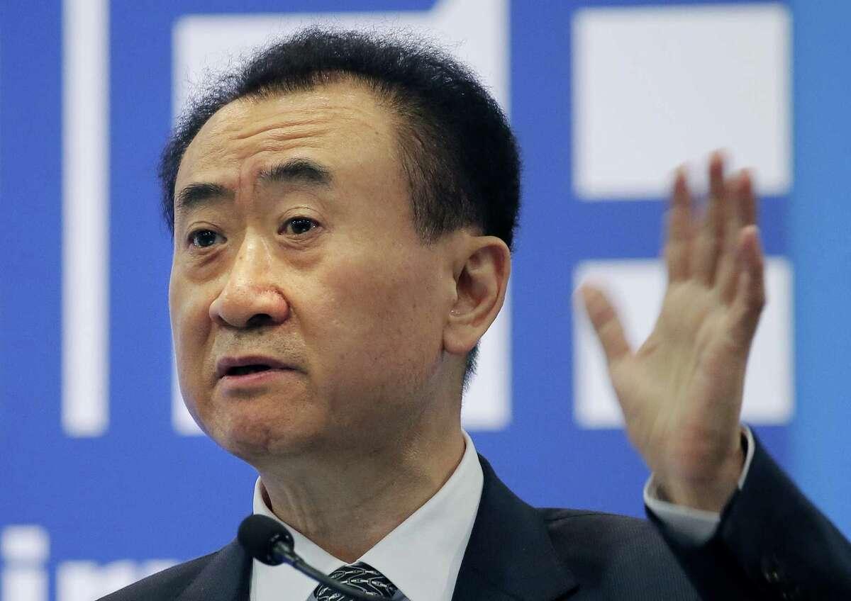 FILE - In this Jan. 18, 2016 file photo, Wang Jianlin, chairman of Wanda Group, delivers a speech at the Ninth Asian Financial Forum in Hong Kong.