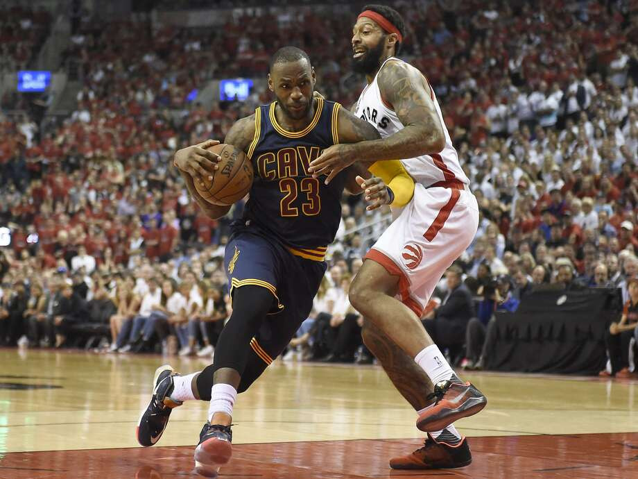 Cleveland Cavaliers forward LeBron James drives to the basket as Toronto Raptors forward James Johnson defends during the second half of Game 6 of the NBA basketball Eastern Conference finals, Friday, May 27, 2016, in Toronto. (Frank Gunn/The Canadian Press via AP) Photo: Frank Gunn, Associated Press