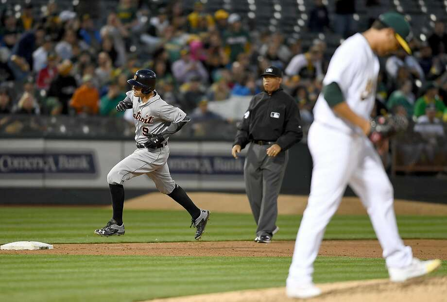 Detroit Tigers third baseman Nick Castellanos trots around the bases after hitting a solo homer off the A's Sean Manaea. Photo: Thearon W. Henderson, Getty Images